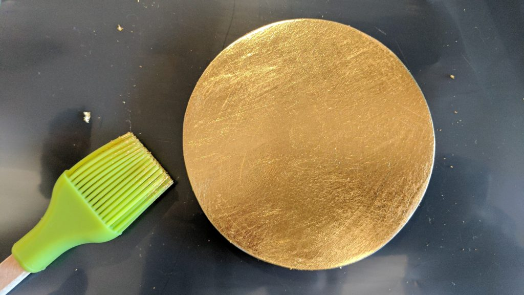 Coaster with gold leaf applied